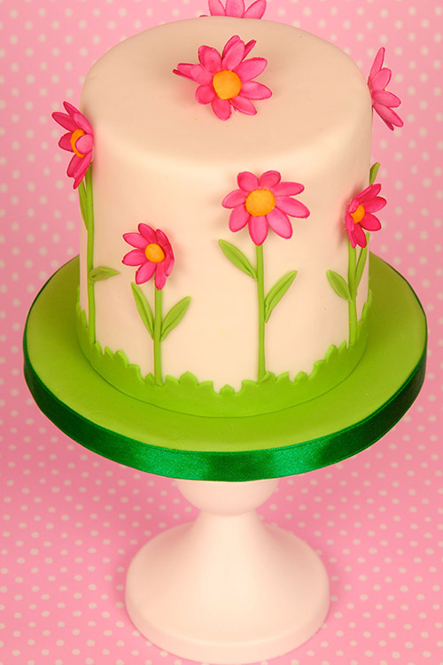 Birthday cake with flowers designed by JD Cake Designs