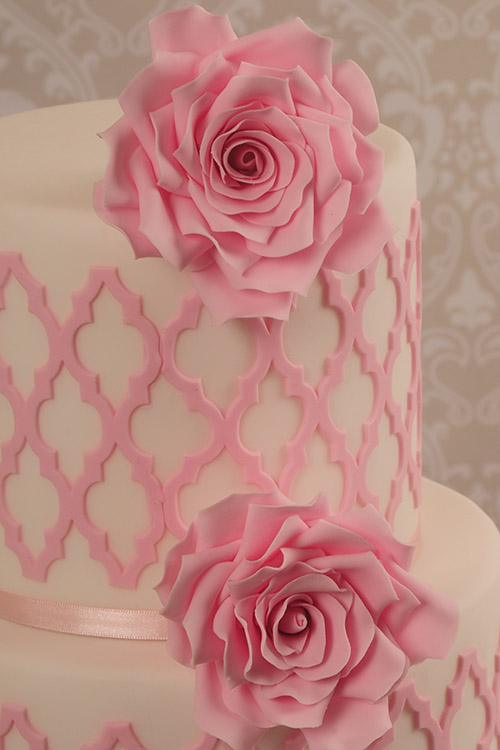 Wedding cake white wtih pink roses designed by Janet Dobie from JD Cake Designs