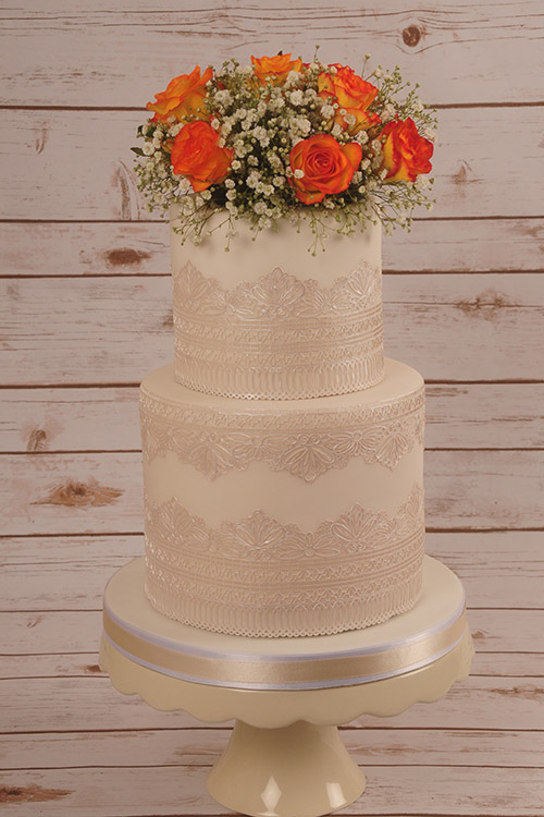 Wedding cake with orange roses designed by Janet Dobie from JD Cake Designs