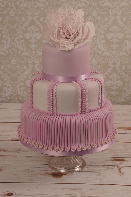 purple, pink and white Wedding cake designed by Janet Dobie from JD Cake Designs