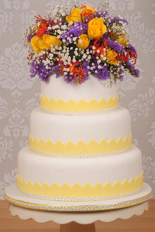 yellow and white Wedding cake designed by Janet Dobie from JD Cake Designs