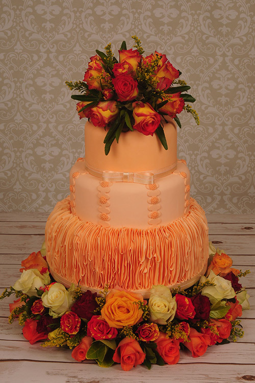 Wedding cake apricot wtih roses designed by Janet Dobie from JD Cake Designs